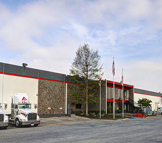 Anderson_Hay_Trucks_in_front_of_PSW_Plant